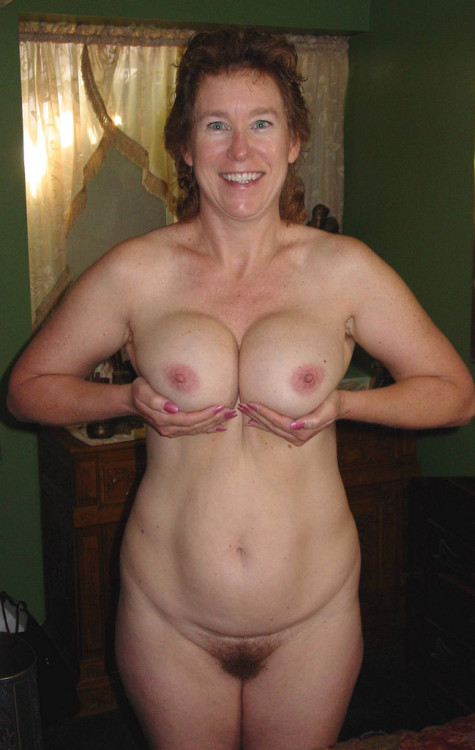 Gorgeous mature nude wife has more than 2 handfuls for your suckling pleasure.