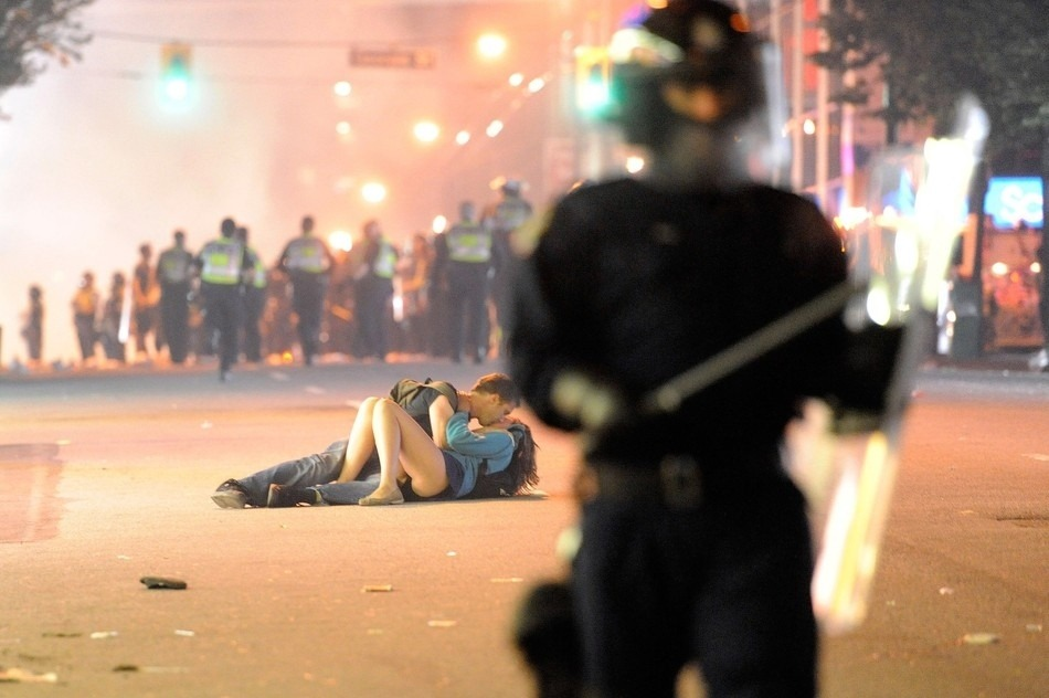 A couple kisses while fallen on the ground during the Vancouver riots in June 2011. Rich Lam
