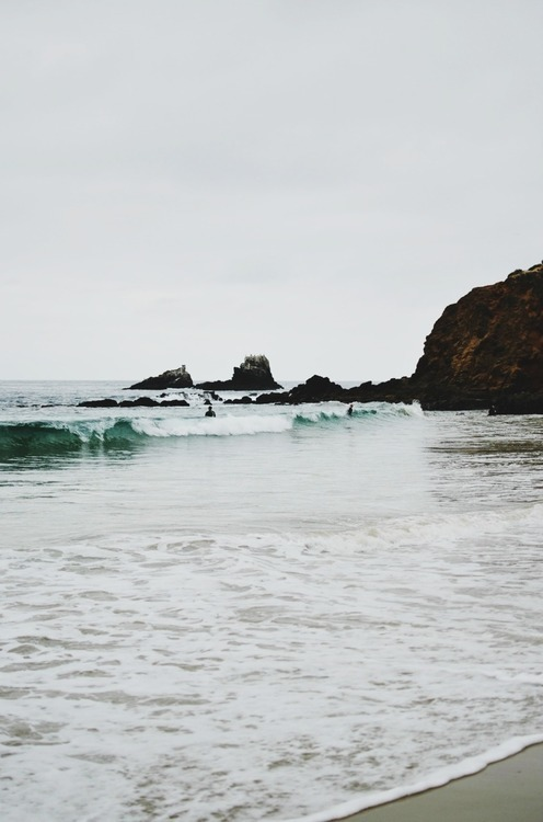 travelaway:  Travel Blog ♥  THE ROCKSI wade in the cold,Waves up to my waist.Rocks loom before me,Victims of the sea.Honed to perfection,Faces to the sky.They stand in silenceAs I join their line.