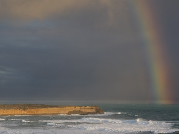 sunset rainbow at Twelve Apostles