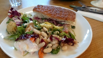 """Tower Records' café's brie and cranberry on focaccia and a slew of different """"salads,"""" including pasta salad, potato salad, white bean salad, and arugula salad"""