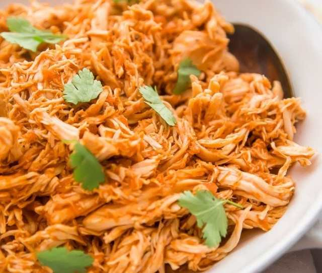 Shredded Mexican Chicken In A White Bowl