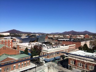 The mountains, market, and downtown from the rooftop