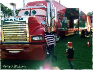 Mumma poses beside Mack from Cars