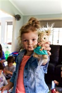 Girl holds an Eleanor Chipmunk plush toy