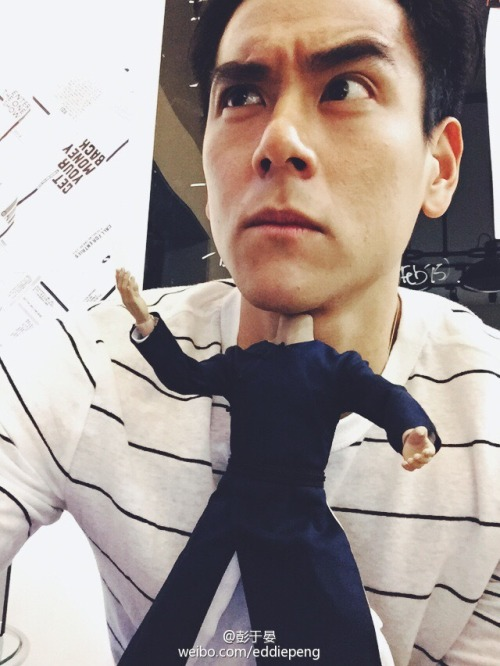 Eddie Peng playing with action figure of himself