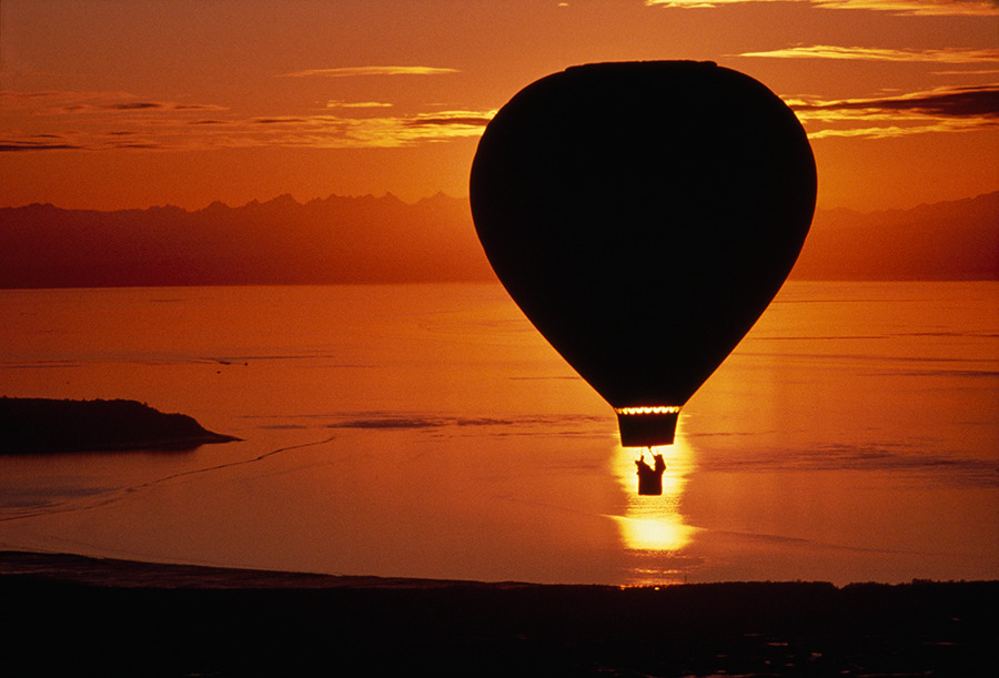A balloon from Anchorage, Alaska, flies over Cook Inlet, 1986. Photograph by Chris Johns, National Geographic Creative