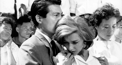 """Iremember everything,"""" says a disparate female voice, as if in agony. """"You remember nothing,"""" a male voice replies to her. He says it again. """"Nothing."""" The opening minutes of Alain Resnais' 1959 debut featureHiroshima, Mon Amourare arguably the most interesting, as they explore the irrevocable damage caused by the atom bomb dropped on Hiroshima during World War II. Bobbing in and out of hospital corridors, museum exhibits, and looking at survivors on the city streets, the themes of this opening ripple throughout the film. It is the film at its most potent and, in a way, most prescient. What is the difference between sympathy and empathy? Where is it useful and where is it dangerous? What is the difference between memory and experience, and memory and third hand witness? Nearly 60 years after Resnais' film, weare livingin a fairly interesting age where not only where mass media can cover international and domestic tragedies with immediate turnaround, even on the front lines, as it were. On Twitter, you could follow the events of Ferguson, MO or the events in Middle East, all in front of you in an instant. But the internet has also allowed this illusion of the eye witness account to proliferate exponentially. This has made sympathy and empathy, and the experience of tragedy, blurred and muddled, also making the questioning of those emotions more relevant. […]  - The Awful Truth: Alain Resnais' Hiroshima, Mon Amour // The Black Maria"""