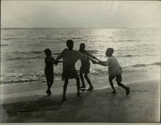 Children playing on a beach, 1940s