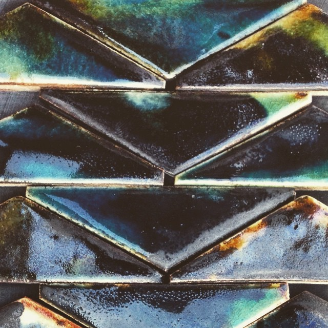 Beauty in imperfection. #tiletuesday #triangle #inky #black #blue #tortoiseshell #handmadetile #stoneware #glaze #guymitchelldesign #pattern #interiordesign #interior #lux #decor #wall #hotel #restaurant #luxury #home #architecture