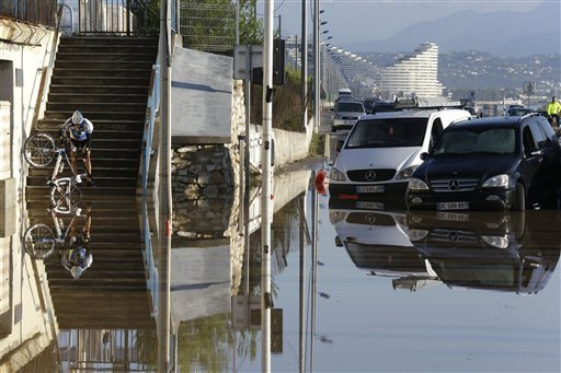 It's a disastrous weather day. Not just in the United States, either..From the AP:  A man carrying his bicycle tries to make his way after floods in Biot, near Cannes, southeastern France, Sunday Oct.4, 2015. Sudden heavy rains around the French Riviera have killed at least 10 people, including some trapped in cars, a campsite and a retirement home, and left six missing. Car and train traffic was disrupted along the Mediterranean coast. (AP Photo/Lionel Cironneau)
