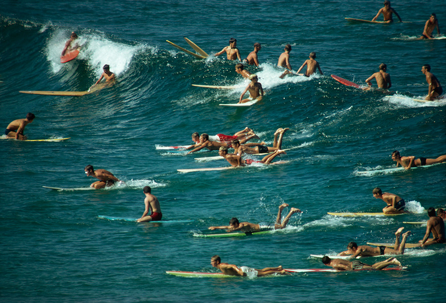 Surfers overpopulate the waves off of Bondi Beach in Australia, 1963. Photograph by Robert B. Goodman, National Geographic Creative