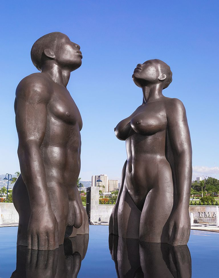 ckamaria:</p> <p>This statute known as 'Redemption Song' is located at Emancipation Park in Kingston, Jamaica, which was constructed in July 2002 according to its website. The work is symbolic of the emancipation of Jamaicans from slavery in 1838. From what I've gathered, it was done by a Jamaican artist, Laura Facey Cooper, and was considered controversial by many Jamaicans because they believed it promoted nudity.  In addition to that, many of them were offended by the male statue's nakedness, in particular, his penis size, and also that the sculptor was too 'light-skinned'.<br /> The dichotomy is that the opposition to the statue are prime examples of how the body can be freed easily, but freeing the mind requires more work, which causes us to question whether slavery has truly ended.  Those views about the 'color' of the sculptor & black nudity lends itself to an uneducated public on artistic concepts; and the deeply-embedded facets of white supremacy coupled with the erasure of African memory.<br /> In many parts pre-colonial Africa, nudity wasn't largely regarded as sexual but rather, a way to deal with humid conditions, however, when the slave traders arrived, they viewed the so-called rampant nudity as indicative of a savage sexual nature. Once enslaved in these foreign lands, African men & women were mentally reconditioned to accept a Westernized view of themselves & to embrace & idolize whiteness. This, of course, went on for centuries spanning several generations.<br /> To that end, here we are, in the 21st century, dealing with a statue that's suppose to be a tribute to freedom.  The sculptor's vision of having the bodies rise from water reconnects to the African philosophy of the power of water with its ability to cleanse & renew.  The nakedness factors into the concept of freedom as both the man and woman gaze upwards to God, presenting themselves as vulnerable & in search of heavenly guidance.  For me, the statue is divine but I am almost certain that if a statue of this kind was done in the States, it may damn near send some twisted individuals into a certified tizzy. </p> <p>