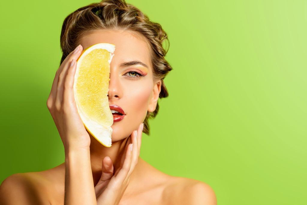 Woman Holding Lemon Green Background