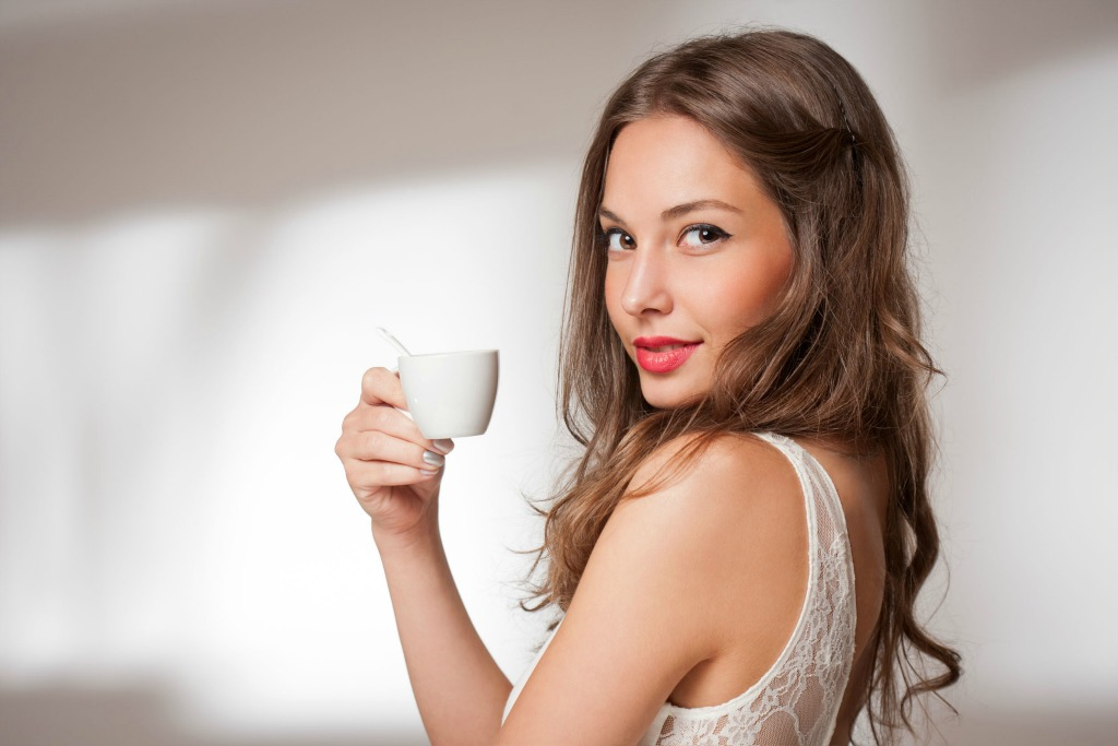 Gorgeous Young Woman Drinking Espresso