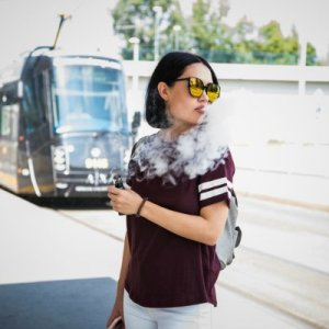 Asian Girl Vaping Train Station