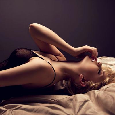 Sensual Blonde Posing in Bed