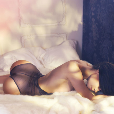 Sensual Woman Chilling Bed Lingerie