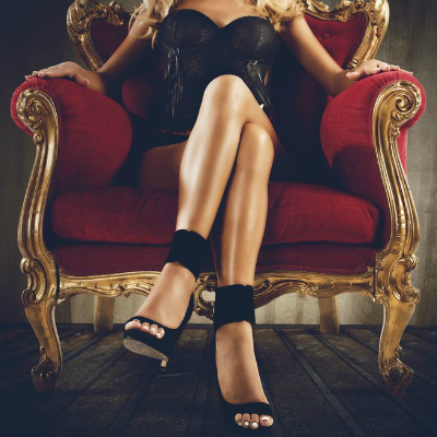 Woman Legs Red Gold Couch