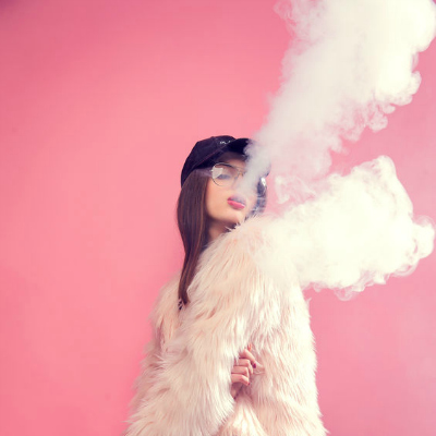 Seductive woman Vaping pink background