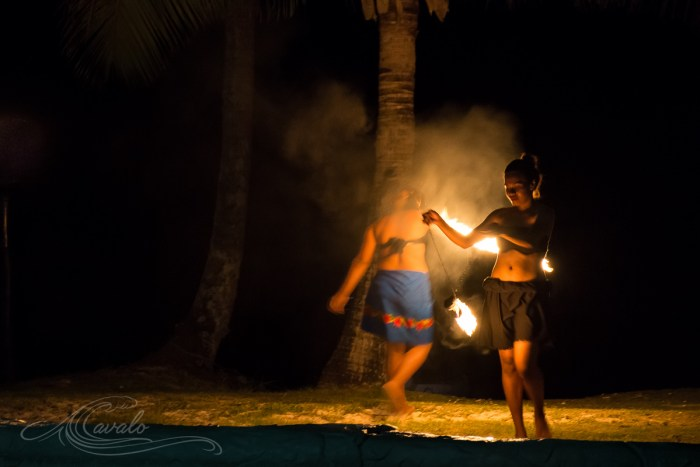 fijian woman with fire poi