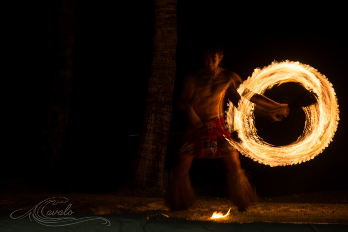 man spinning fire poi in fiji