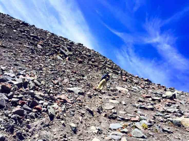 scrambling through shale up South Sister Oregon