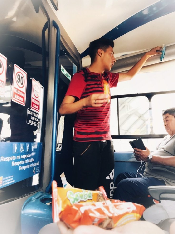 child selling candy on a bus