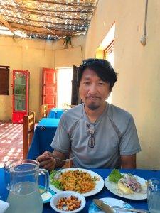Trin with his Ceviche in Peru