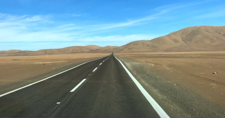 The long straight road in the Atacama desert toward Pisagua in Northern Chile
