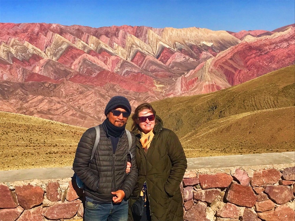 standing in front of a mountain of fourteen colors, colors of freedom
