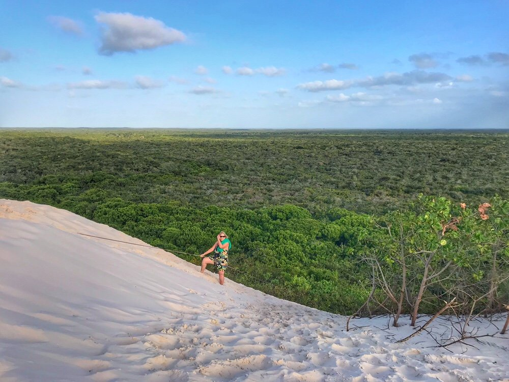 Climbing the sand dune into Lençóis Maranhenses National Park the Most beautiful place in the world