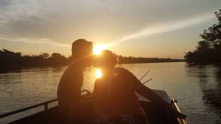 Kissing in the sunset on the Amazon