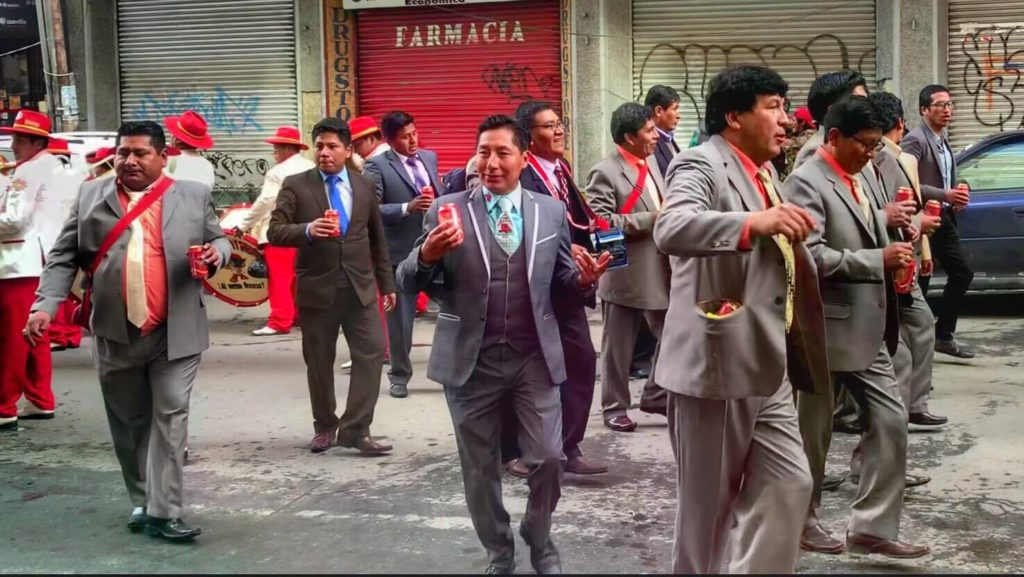 Drinking in a parade is a standard holiday tradition in Bolivia