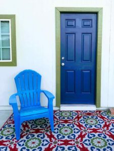 A blue front door with a blue chair outside