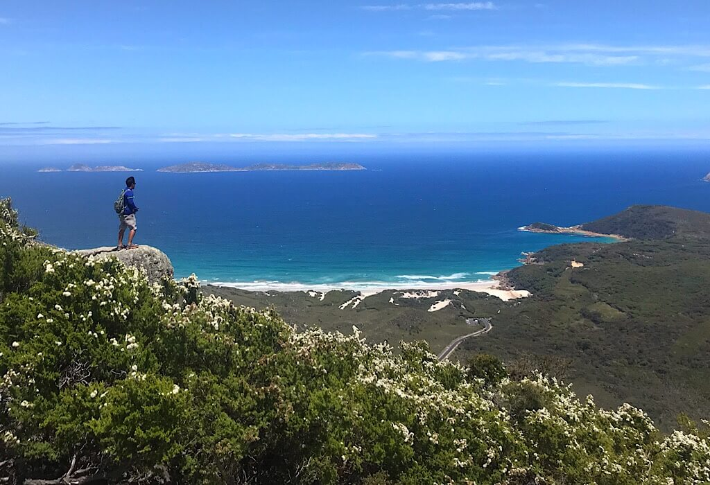 Trin standing on top of Mt Bishop in Wilson's Promontory, VIC, Australia