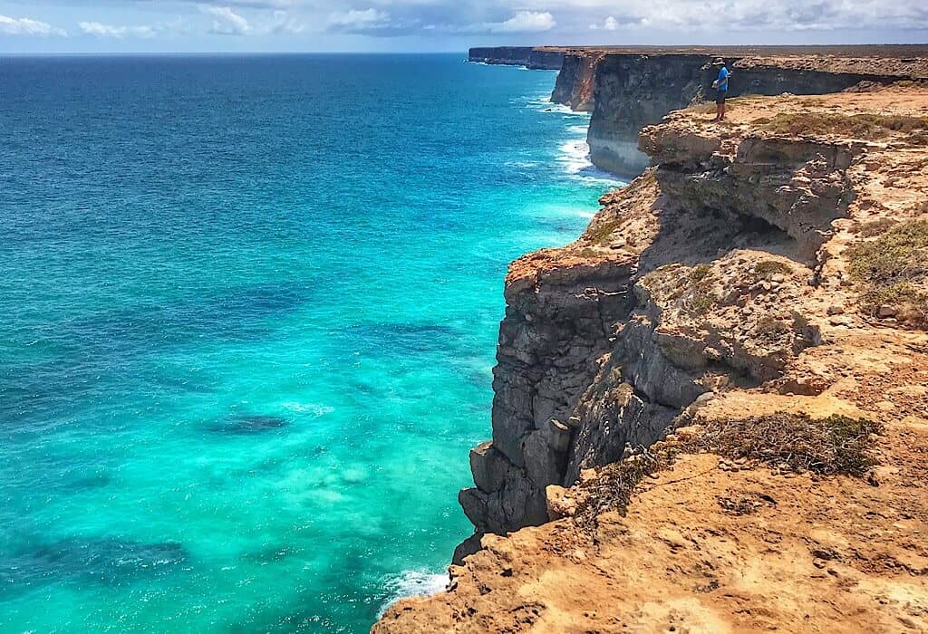 Trin standing on the cliff edge of the Nullarbor overlooking the Great Australian Bight