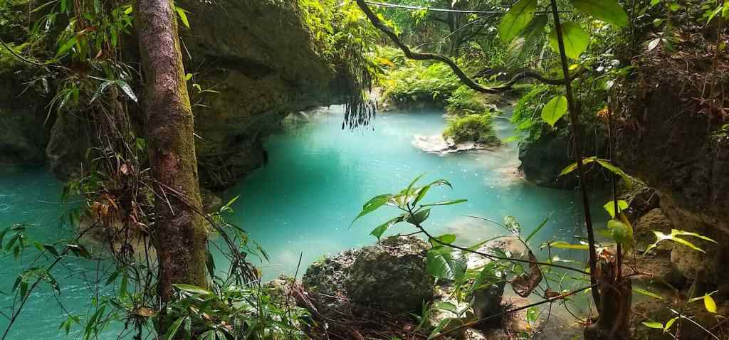 The blue river waters in the woods on Siquijor