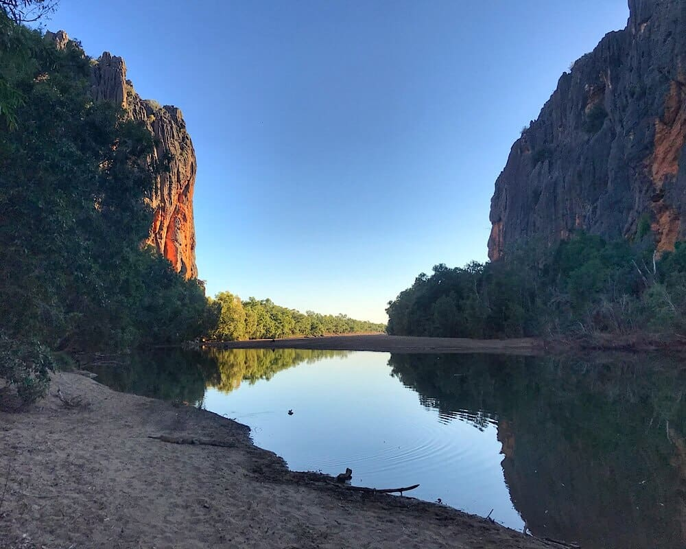 The sun is setting over Lennard River in the Windjana gorge.