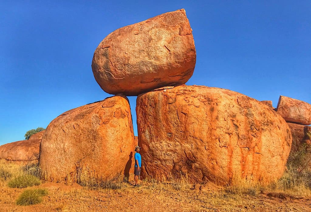 Trin trying to hide between the boulders at Devils Marbles
