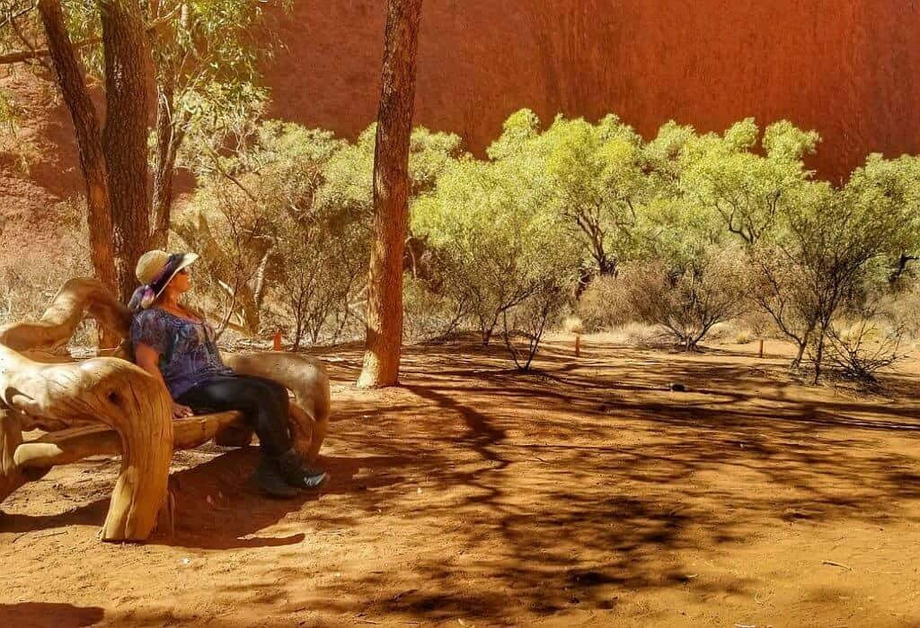 Bonnie sitting on a bench at the base of Uluru