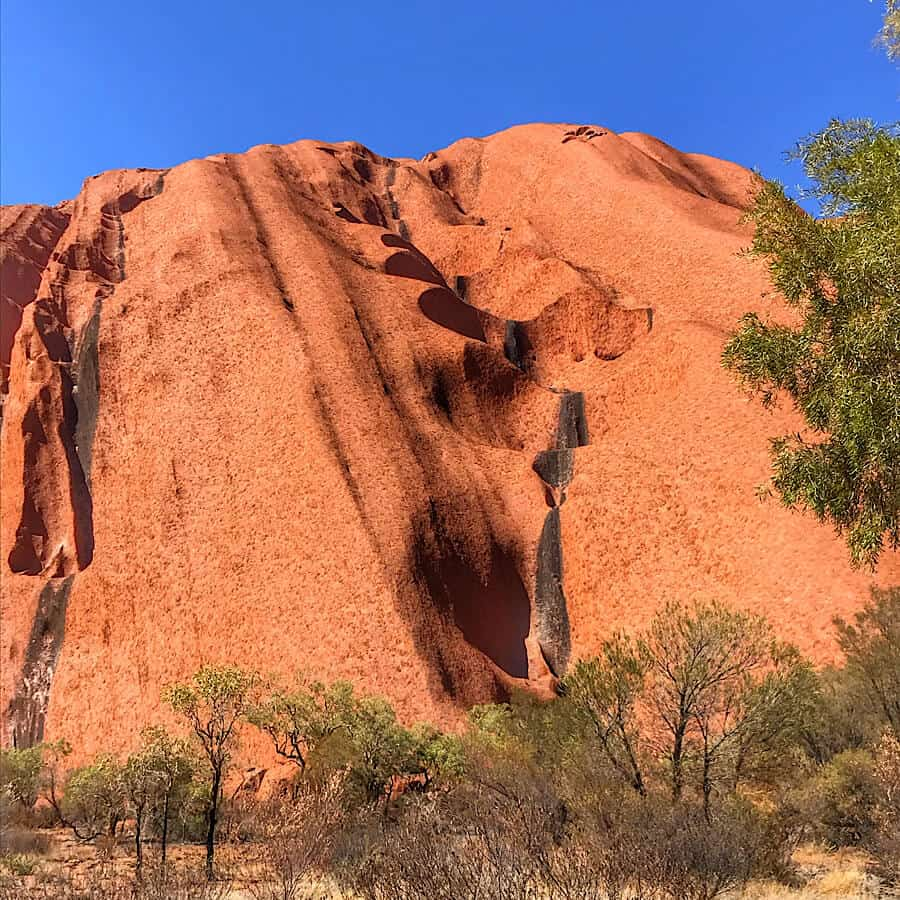 A dry riverbed on the side of Uluru