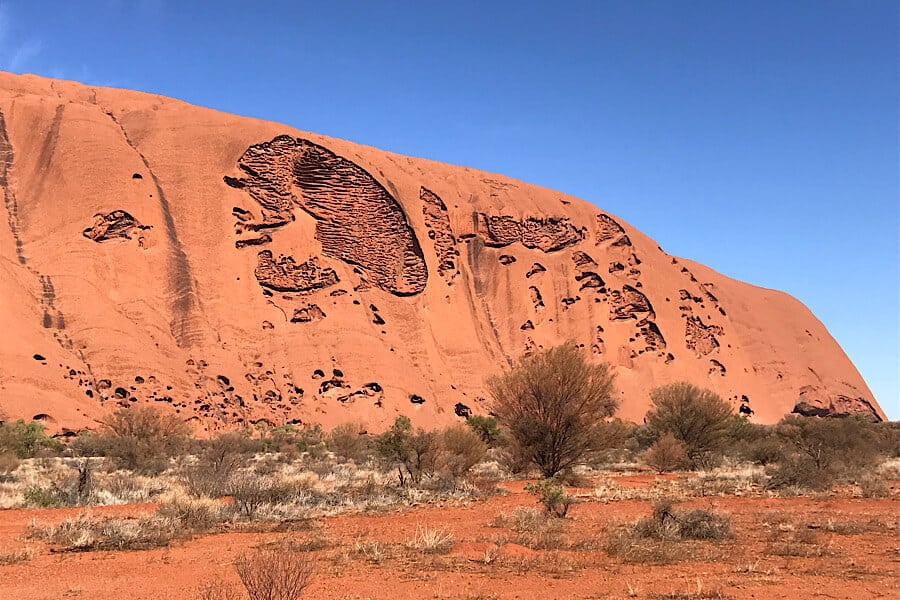 A side of Uluru with intricate designs.