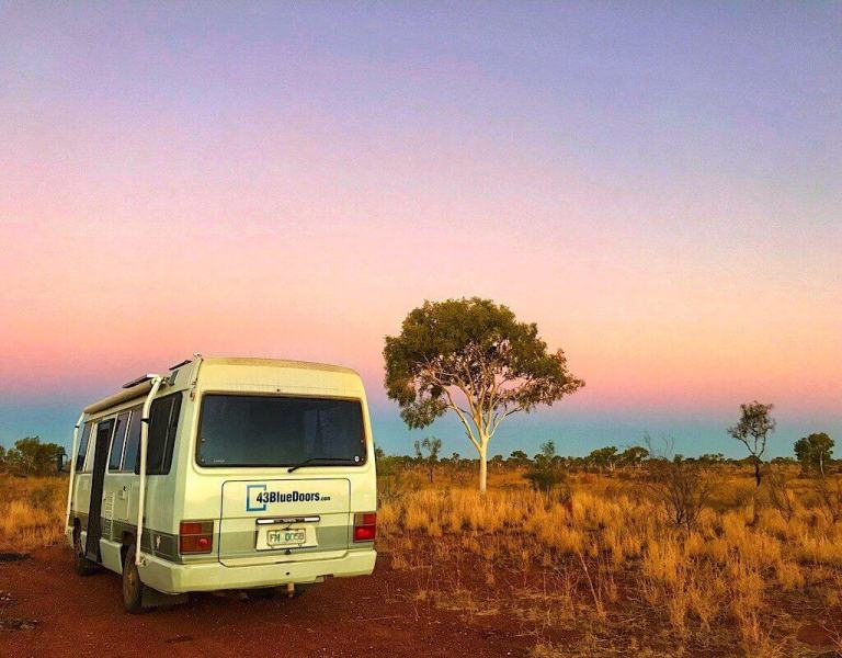 Lil' Beaut our Toyota Coaster and home camped in the outback of the Northern Territory