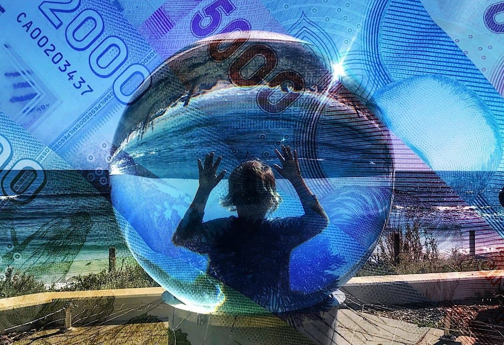 Aboriginal child looking through a glass ball on the beach in Australia. Money overlays the picture