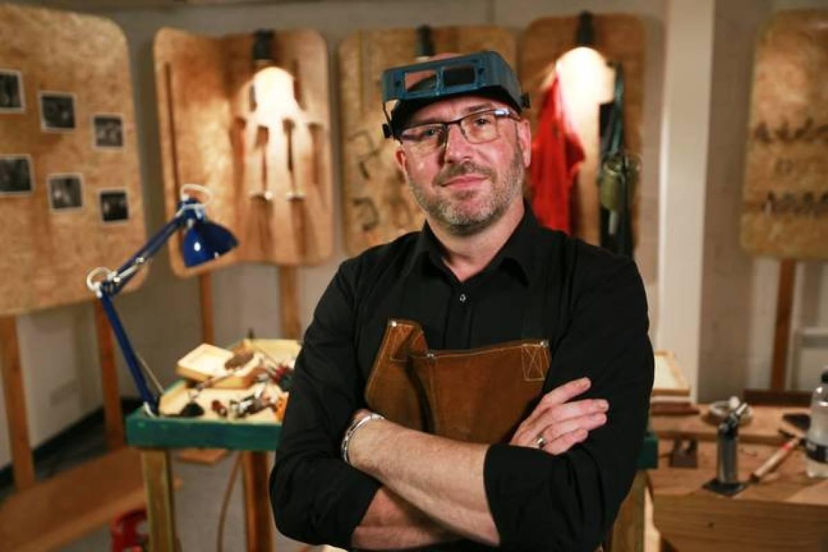 Expert David Thomas in the Bling Repair Shop.  (Credit: ITV)