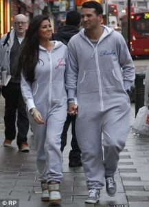 Two former Catholics (now excommunicated) wearing mortally sinful matching onesie's.