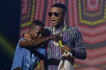 Wizkid Signs 12 Year Old To Starboy Records At #WizkidTheConcert Gives Him N10million