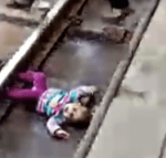 Video: Heart-Stopping Moment 1-Year-Old Baby Fell Onto Train Tracks And A Train Passed Over Her But She Miraculously Survived Without A Scratch