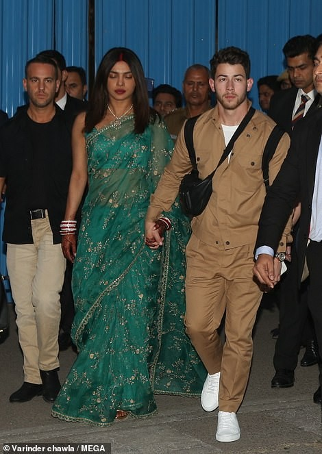 Newlyweds Priyanka Chopra and Nick arrive in style to celebrate another wedding reception in Delhi (Photos)